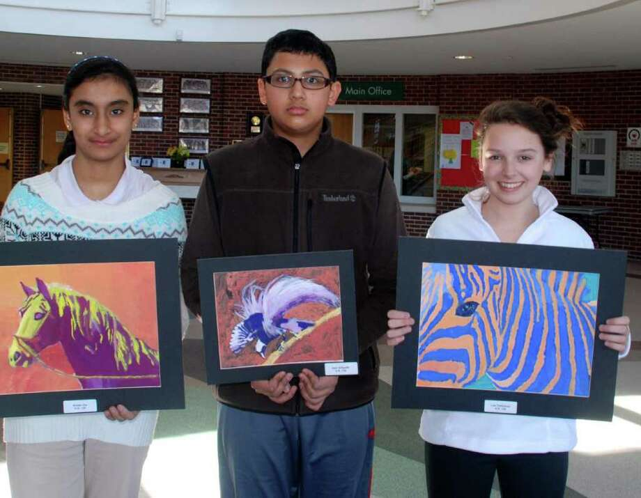 "Middlesex Middle School's Parent's Association will host ""A Celebration of the Arts"" fundraiser Saturday, April 9, from 6pm until 8pm at Middlesex school. Pictured showing off their art work are MMS students Amber Zia, Harinandan Srikanth and Lee Thalhamer. Photo: Contributed Photo / Darien News"