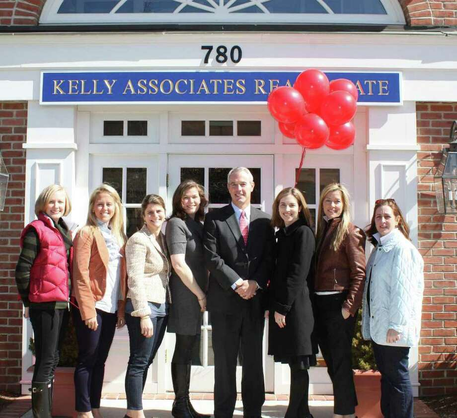 Kelly Associates have partnered with OPUS for Person-to-Person for the annual Balloons for Campers Day fundraiser. Pictured, from left are OPUS members and Kelly Associates realtors Sara Franzese, Deborah Hidy, Kim Swift and Cristie Veeder; Kelly Associates Vice President Jeff Kelly; event co-chairman Kristie Calvillo; OPUS member and Kelly realtor Kate Bates; and event co-chairman Erica Wood. Photo: Contributed Photo / Darien News
