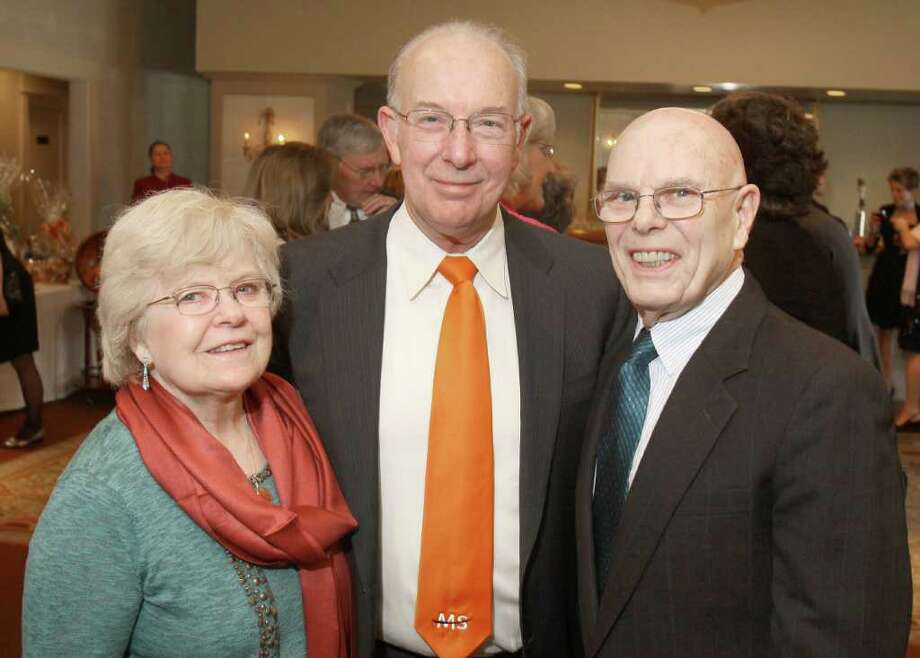 Albany, NY - March 26, 2011 - (Photo by Joe Putrock/Special to the Times Union) - Event chairperson Dr. Keith Edwards, MD(center) poses with Patricia(left) and Henry(right) Binzer during A Festive MS Gala presented by the Upstate NY Chapter of the National Multiple Sclerosis Society and the MS Resource of the Tristate Area to support multiple sclerosis education and research. Photo: Joe Putrock / Joe Putrock