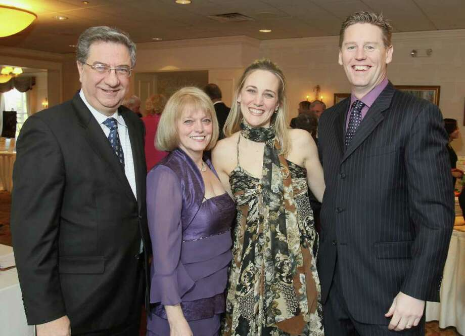 Albany, NY - March 26, 2011 - (Photo by Joe Putrock/Special to the Times Union) - Event chairperson Christine Sisto Mertes(2nd from right) poses with her parents Daniel(left) and Susan(2nd from left) Sisto and her husband Bill Mertes(right) during A Festive MS Gala presented by the Upstate NY Chapter of the National Multiple Sclerosis Society and the MS Resource of the Tristate Area to support multiple sclerosis education and research. Photo: Joe Putrock / Joe Putrock