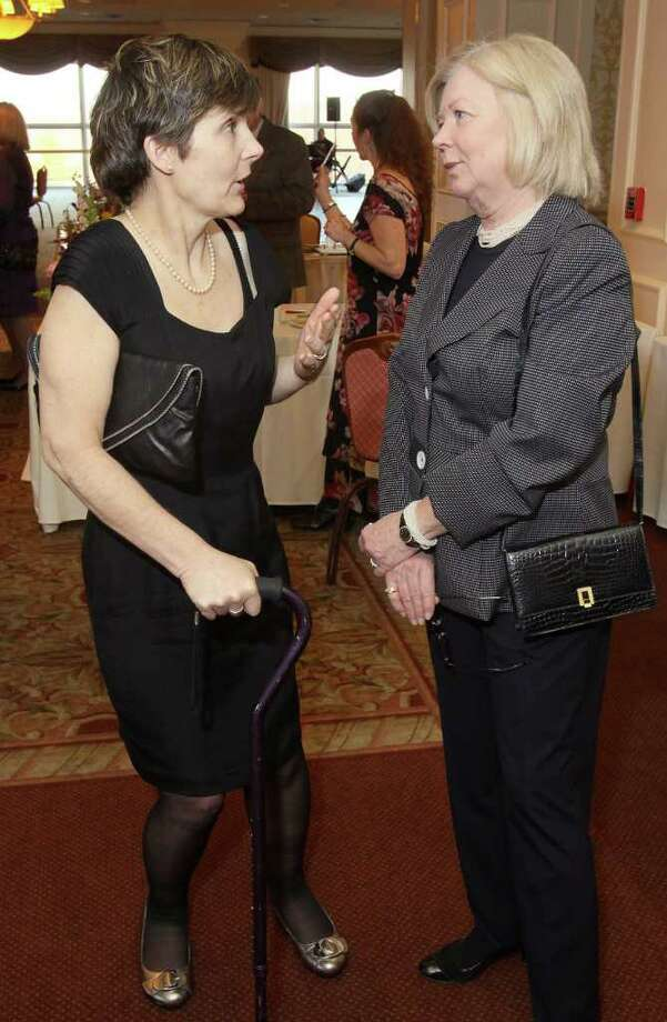 Albany, NY - March 26, 2011 - (Photo by Joe Putrock/Special to the Times Union) - Lauren Plante(left) talks with Rebecca Robinson(right) during A Festive MS Gala presented by the Upstate NY Chapter of the National Multiple Sclerosis Society and the MS Resource of the Tristate Area to support multiple sclerosis education and research. Photo: Joe Putrock / Joe Putrock