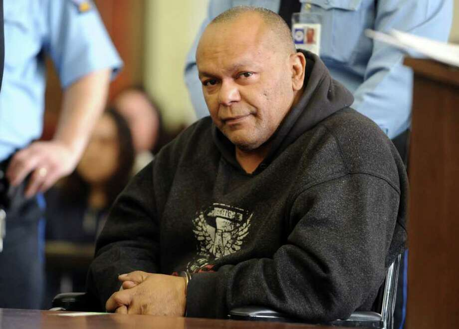 Fifty-five-year-old Wilfredo Fernandez is arraigned on murder charges Friday April 8, 2011 in Superior Court in Bridgeport, Conn. Photo: Autumn Driscoll / Connecticut Post