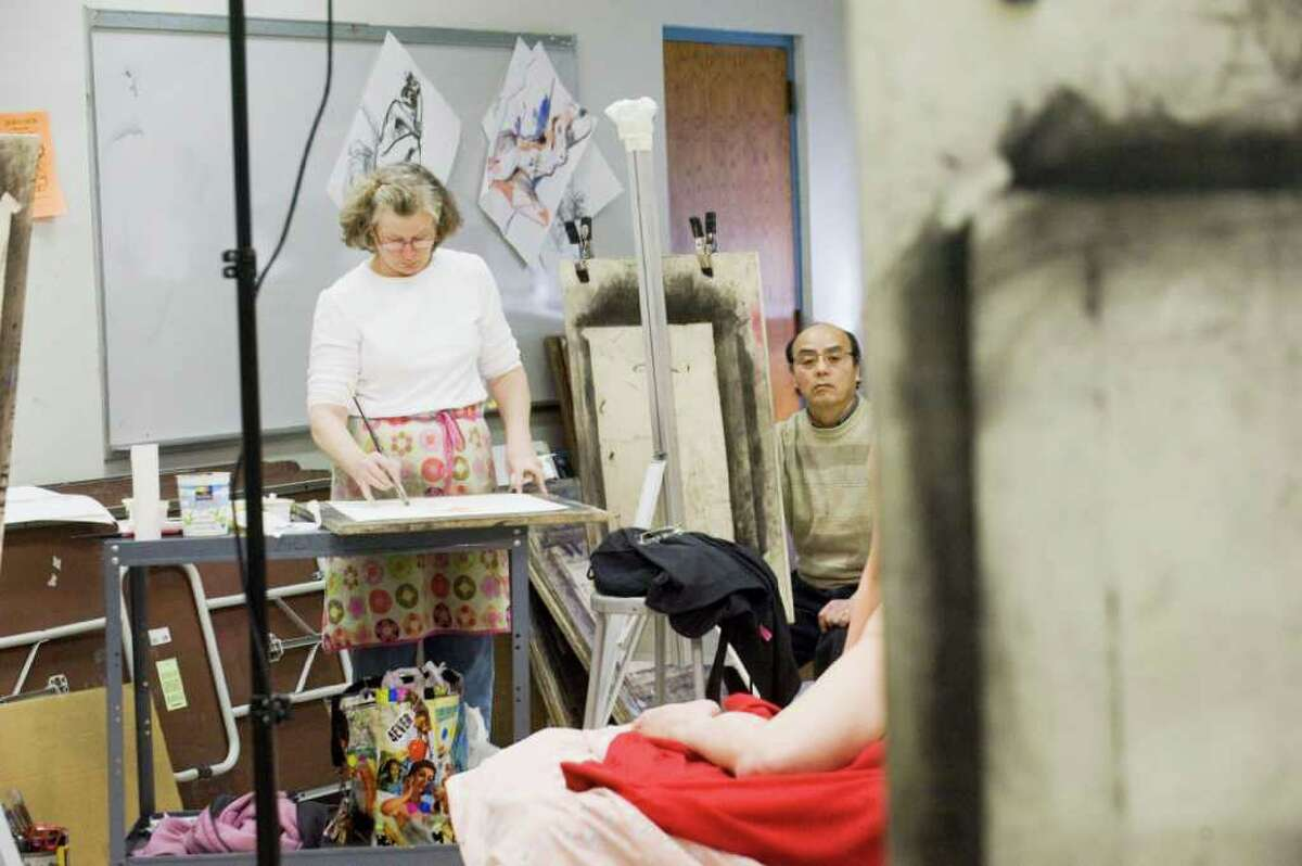 Lori Lohstoeter, a Drawing 1 instructor, and student Koichiro Morikawa participate in the second annual Draw-a-Thon at NCC in Norwalk, Conn. on Friday April 8, 2011. The event was sponsored by the NCC Art, Architecture and Design Department and the Art Club.