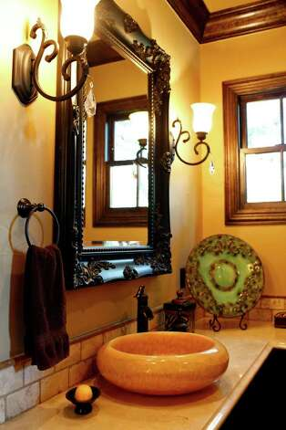 The master bathroom of Fairytale Chateau features classic and simple fixtures. Photo: LISA KRANTZ, SAN ANTONIO EXPRESS-NEWS / SAN ANTONIO EXPRESS-NEWS
