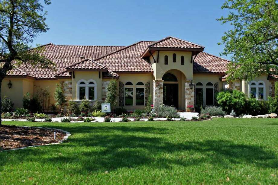Trinity at Stone Creek, built by Trinity Custom Builders, Inc. includes a Tuscan exterior framed with oak trees and a groined vault ceiling with cream and brown marble accents on the floor. Photo: LISA KRANTZ, SAN ANTONIO EXPRESS-NEWS / SAN ANTONIO EXPRESS-NEWS