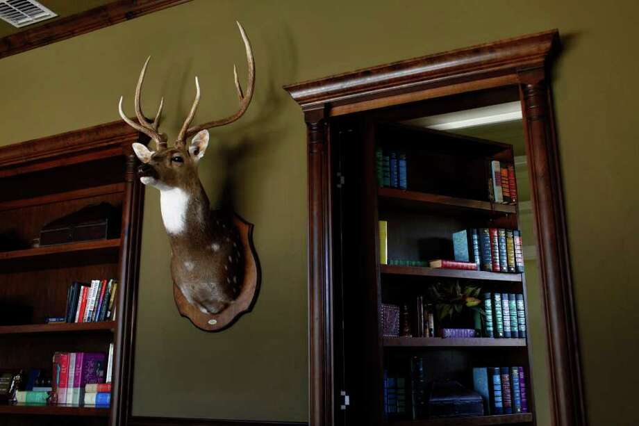 The Chateaux features a study with a bookshelf doubling as a door to a storage area. Photo: LISA KRANTZ, SAN ANTONIO EXPRESS-NEWS / SAN ANTONIO EXPRESS-NEWS