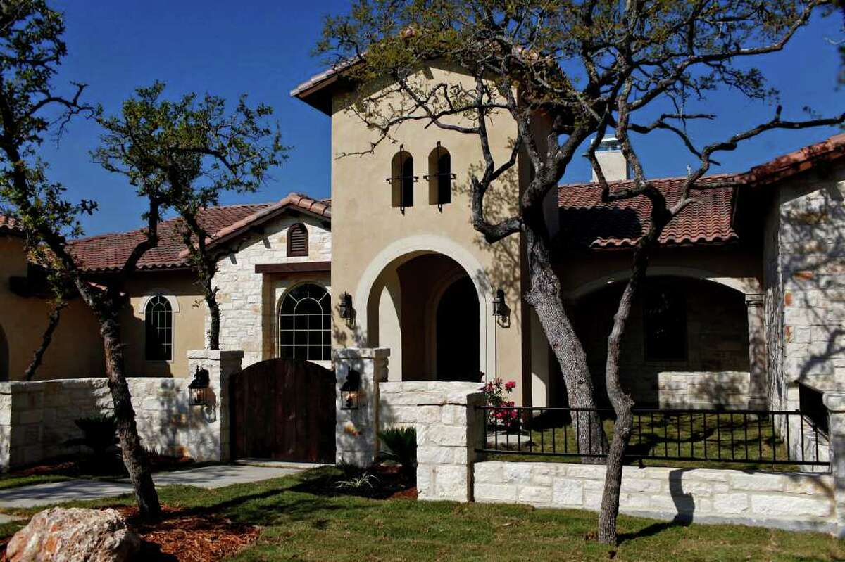 Cedar wood ceiling accents, cantera columns and a breakfast nook with view of raised outdoor living area are just some of the highlights of Villa Cantera, a Pordigy Signature Home, featured in Street of Dreams in Stone Creek Ranch.