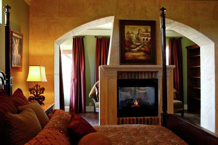 A fireplace is one of the amenities in the master bedroom at The Chateaux in Stone Creek Ranch. Photo: LISA KRANTZ, SAN ANTONIO EXPRESS-NEWS / SAN ANTONIO EXPRESS-NEWS