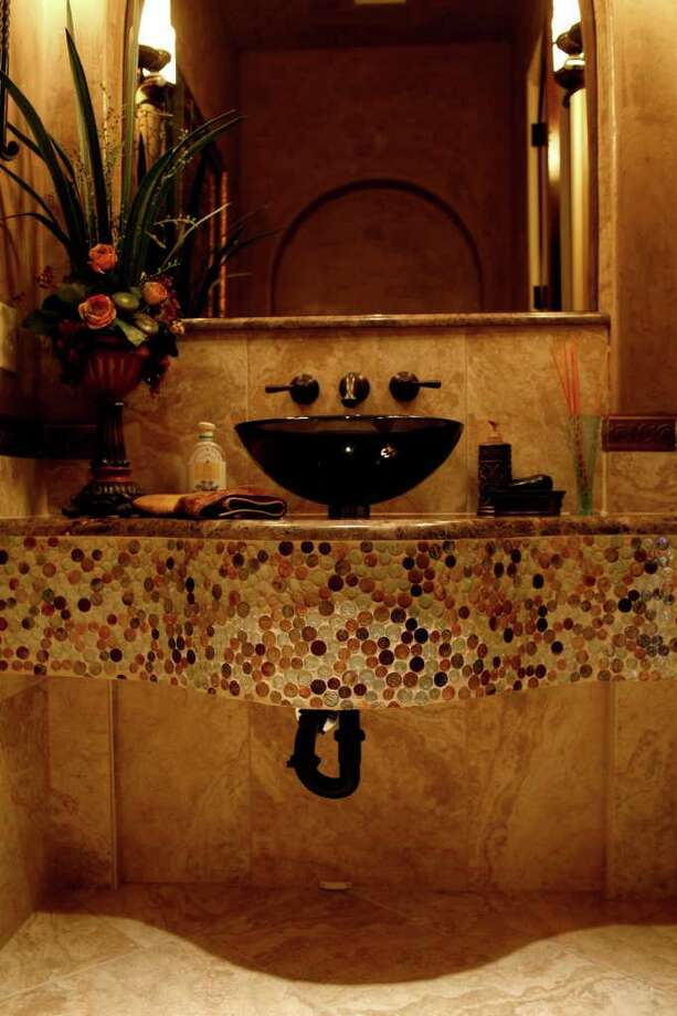 A half-bath in the Trinity at Stone Creek home, by Trinity Custom Builders Inc.  Photo: LISA KRANTZ, SAN ANTONIO EXPRESS-NEWS / SAN ANTONIO EXPRESS-NEWS
