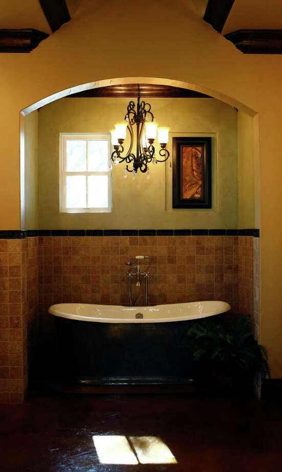 The master bath in Fairytale Chateau, by McCormick Custom Homes, LLC. Photo: LISA KRANTZ, SAN ANTONIO EXPRESS-NEWS / SAN ANTONIO EXPRESS-NEWS