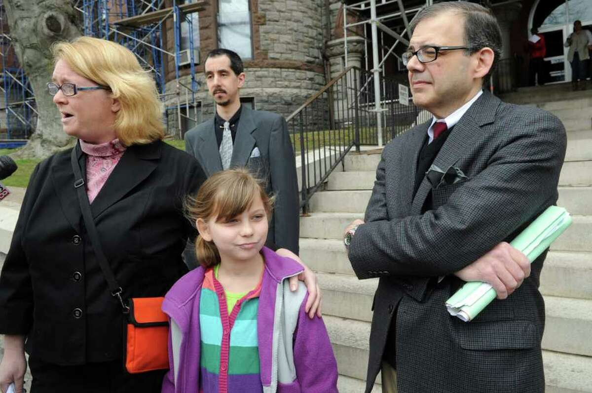 The family of eight-year-old Mike Oricchio, a special needs student who rode Evelyn Guzman's bus, leaves Superior Court in Bridgeport, Conn. Friday, April 8, 2011 following a hearing granting the former Trumbull school bus driver accelerated rehabilitation in lieu of jail time. Guzman was accused of sending and receiving a total of 1,068 text messages while transporting children. From left, Renee Oricchio, Maddie Oricchio, 10, and Michael Oricchio.