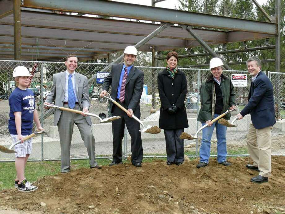Town and school officials officially broke ground for the expansion project at Fairfield Woods Middle School. On hand for the ceremony were, from left, Fairfield Woods student Will Mitola, First Selectman Kenneth Flatto, Fairfield Woods Principal Greg Hatzis, Board of Education member Sue Brand, building committee chairman William Sappone and school board member Perry Liu. Photo: Genevieve Reilly / Fairfield Citizen