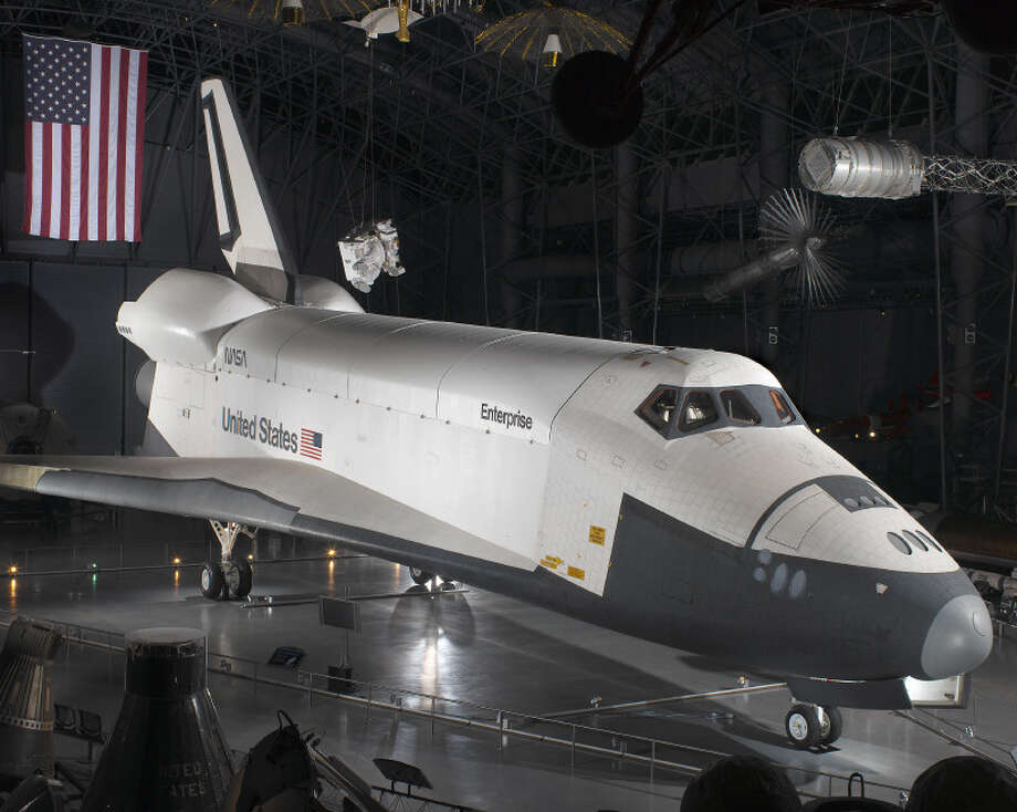 The space shuttle orbiter Enterprise, which NASA used to test atmospheric flight, is seen on display in the Smithsonian National Air and Space Museum's Steven F. Udvar-Hazy Center, in Chantilly, Va. The museum is due to get the orbiter Discovery and give up Enterprise. Photo: Smithsonian National Air And Space Museum