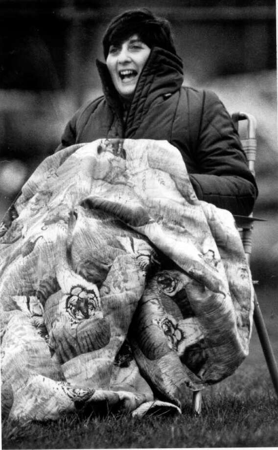 April 11, 1986: Cheering in the rain was the name of the game as Patti Gaudio watched her son Craig pitch for the Stamford High baseball team against Westhill High. Stamford won. Photo: File Photo / Stamford Advocate File Photo