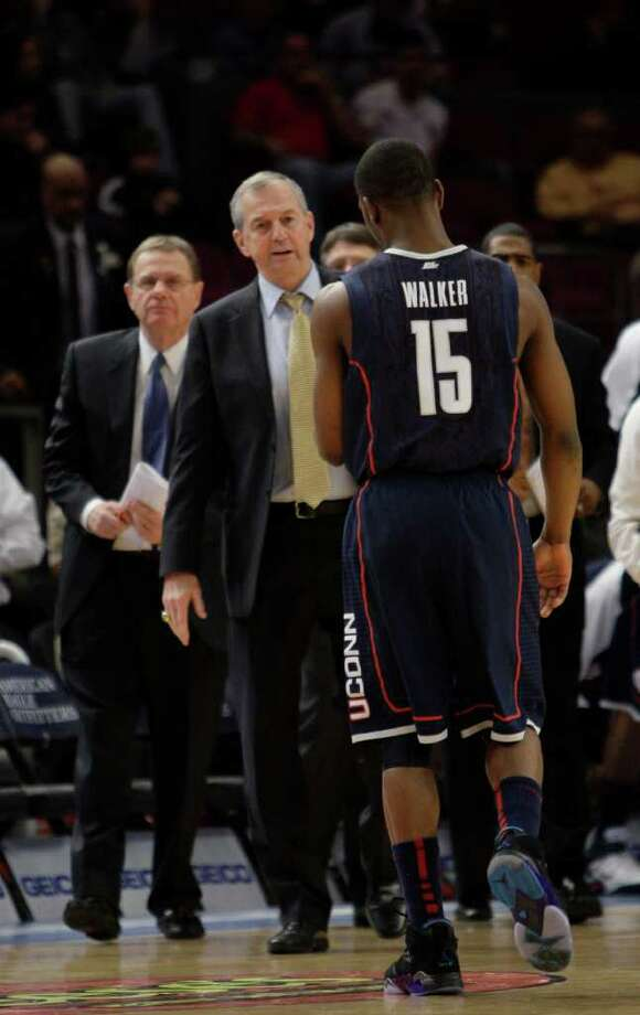 Connecticut's coach Jim Calhoun talks to Kemba Walker during a  time out in the first half of an NCAA college basketball game at the Big East Championship, Wednesday, March 9, 2011 at Madison Square Garden in New York.  (AP Photo/Mary Altaffer) Photo: Mary Altaffer, ST / AP2011