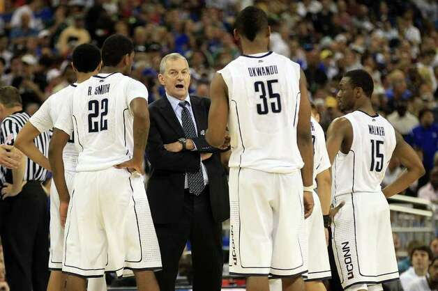 Head coach Jim Calhoun of the Connecticut Huskies talks to his team against the Kentucky Wildcats during the National Semifinal game of the 2011 NCAA Division I Men's Basketball Championship at Reliant Stadium on April 2, 2011 in Houston, Texas.  (Photo by Streeter Lecka/Getty Images) Photo: Streeter Lecka, ST / 2011 Getty Images