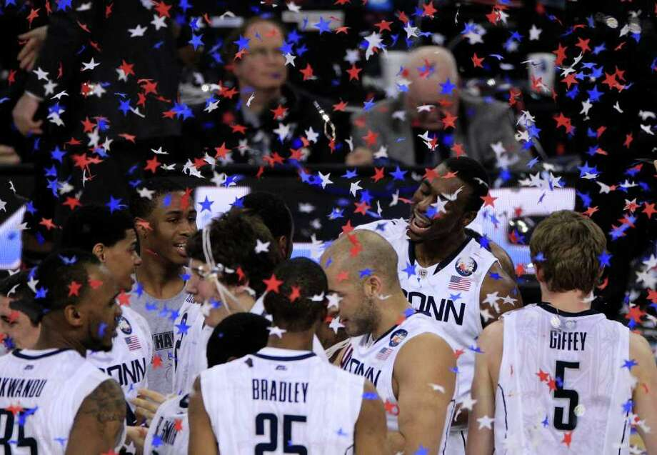 Connecticut guard Kemba Walker (15) (second right) and his University of Connecticut teammates celebrate after defeating Butler 53-41 during the NCAA National Championship at Reliant Stadium on Monday, April 4, 2011, in Houston.  ( Brett Coomer / Houston Chronicle ) Photo: Brett Coomer, Houston Chronicle / Houston Chronicle