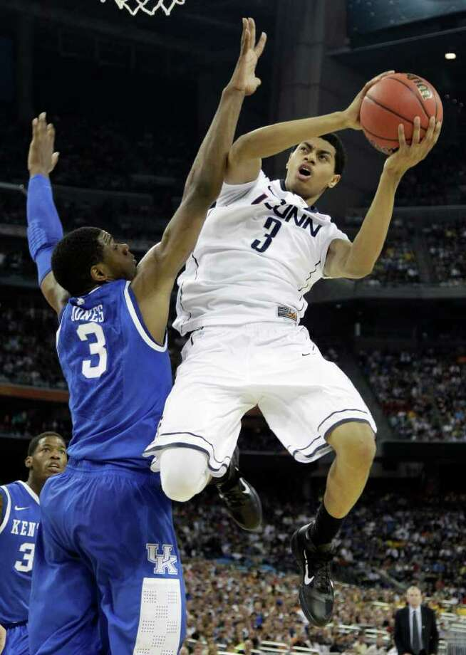 Connecticut's Jeremy Lamb, right, looks to shoot over Kentucky's Terrence Jones, left, during the first half of a men's NCAA Final Four semifinal college basketball game Saturday, April 2, 2011, in Houston. (AP Photo/David J. Phillip) Photo: AP