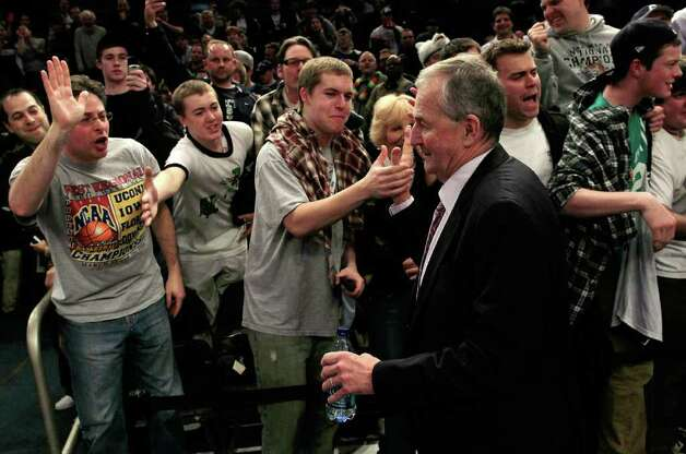 Jim Calhoun, head coach of the Connecticut Huskies, high fives fans as he walks off the court after defeating the Louisville Cardinals during the championship of the 2011 Big East Men's Basketball Tournament on March 12, 2011 in New York City.  (Photo by Chris Trotman/Getty Images) Photo: Chris Trotman, ST / 2011 Getty Images