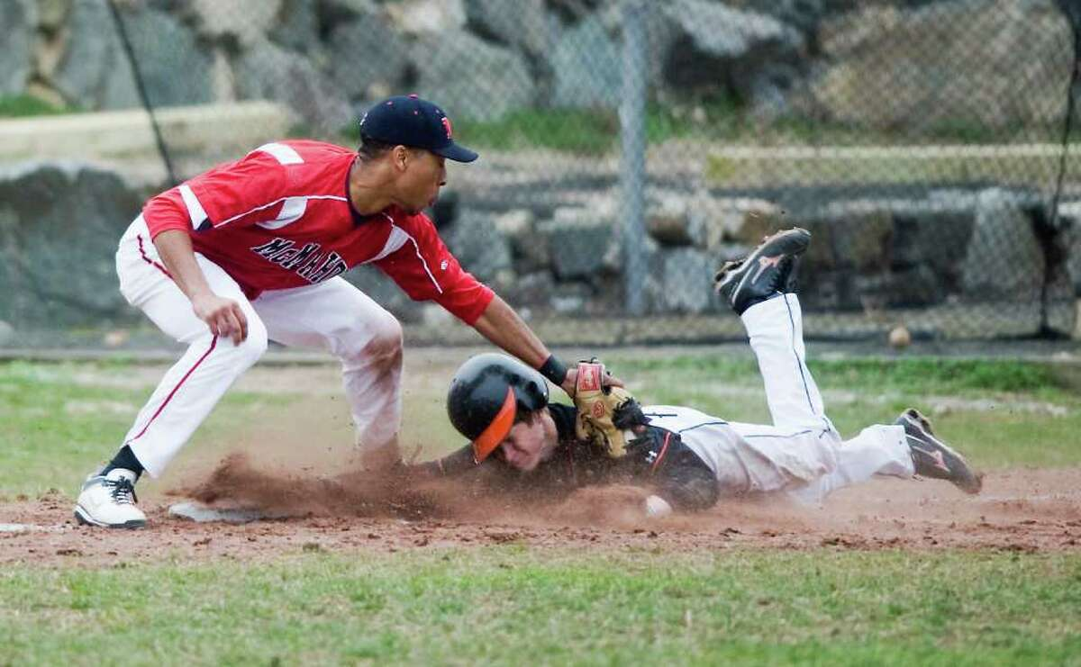 Stamford High's Jeff Cooper beats the tag at third from McMahon's Ronnie Sherman in baseball action at Stamford, Conn. on Friday April 8, 2011.