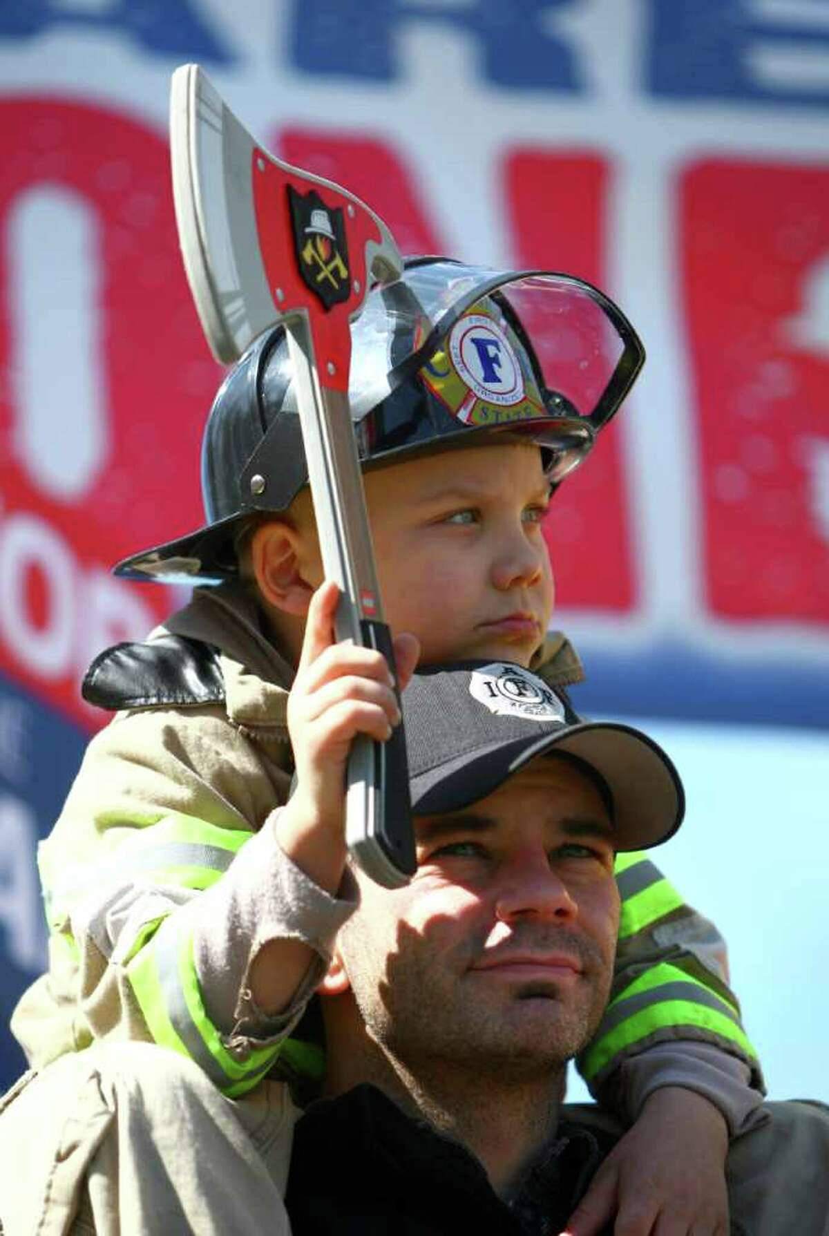 Ryler sits on the shoulders of his dad, firefighter Mike Auvil of Pierce County on Friday on the State Capitol Campus in Olympia.