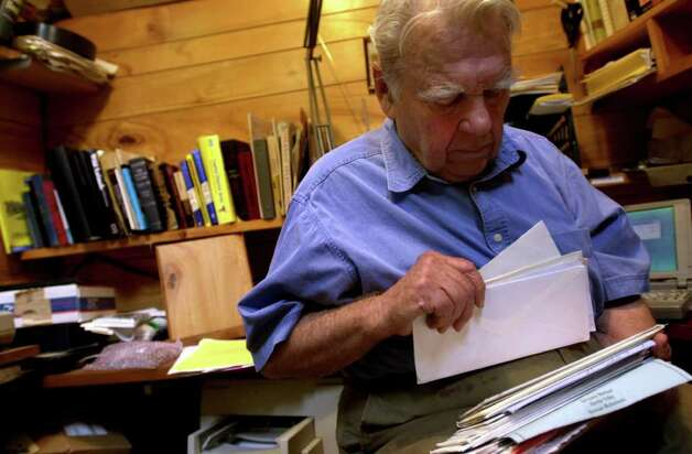"Andy Rooney looks through a stack of fan mail in 2001 in his office, which he calls ""The Pentagon,"" at his home in Rensselaerville, N.Y. (Cindy Schultz/Times Union archive) Photo: CINDY SCHULTZ / ALBANY TIMES UNION"