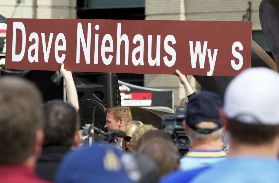 An oversized Dave Niehaus Way sign is held up during Opening Day ceremonies at Safeco Field in Seattle Friday April 8, 2011. Photo: Stephen Brashear, STEPHEN BRASHEAR / Special to seattlepi.com