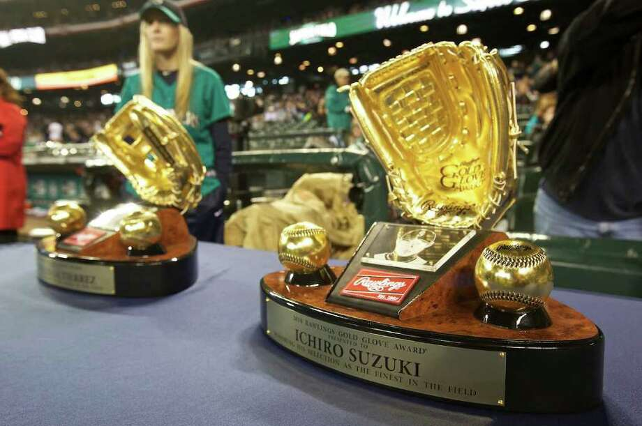 Gold Glove Awards presented to Mariners outfielders Franklin Guitierrez and Ichiro Suzuki sit on a table during Opening Day ceremonies at Safeco Field in Seattle Friday April 8, 2011. va Photo: Stephen Brashear