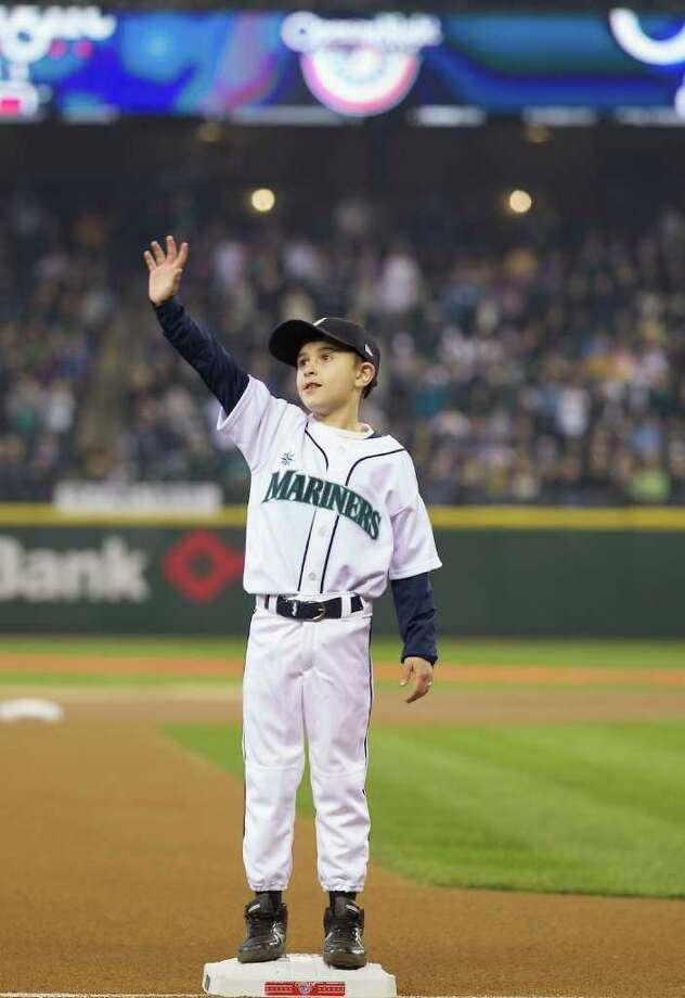 Kamrin Cramer makes the ceremonial run around the bases during Opening Day ceremonies at Safeco Field in Seattle Friday April 8, 2011. Photo: Stephen Brashear