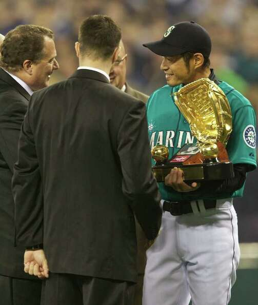 Seattle Mariners right fielder accepts his Golden Glove Award during Opening Day ceremonies at Safec