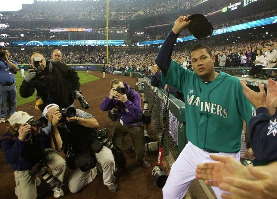 Seattle Mariners Cy Young Award-winning pitcher Felix Hernandez acknowledges the crowd before being presented with his award during Opening Day ceremonies at Safeco Field in Seattle Friday April 8, 2011. Photo: Stephen Brashear