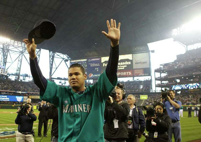 Seattle Mariners Cy Young Award-winning pitcher Felix Hernandez acknowledges the crowd before being