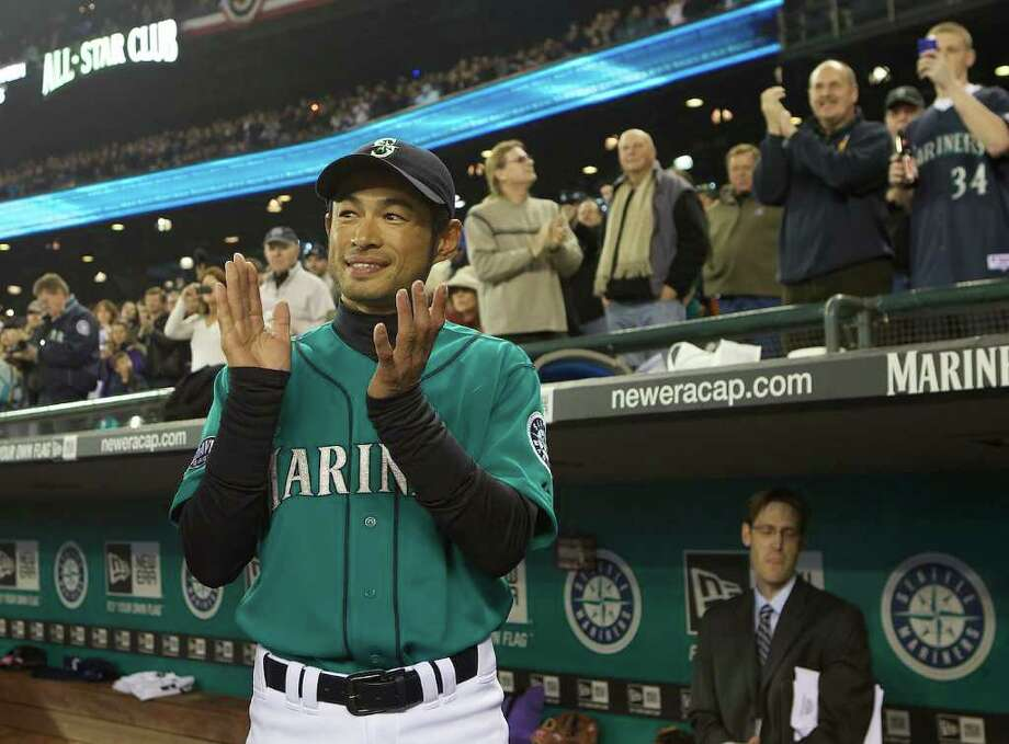 Seattle Mariners rightfielder Ichiro Suziki applauds teammate and Cy Young Award winner Felix Hernadez during Opening Day ceremonies at Safeco Field in Seattle Friday April 8, 2011. Photo: Stephen Brashear