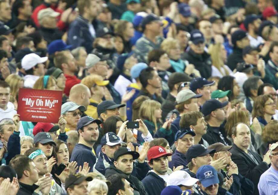 A fan holds up a sign while honoring former Mariners announcer Dave Niehaus during Opening Day ceremonies at Safeco Field in Seattle Friday April 8, 2011. Photo: Stephen Brashear