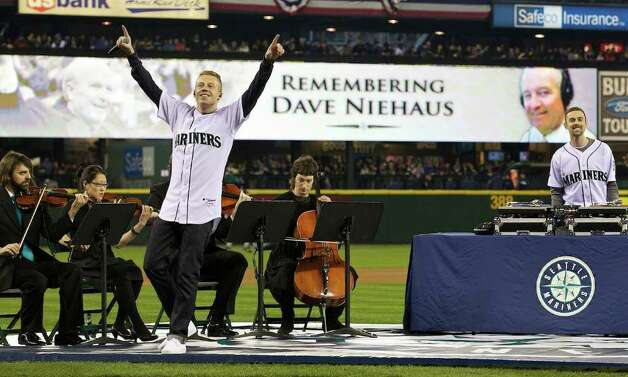 Seattle musician Macklemore performs a tribute to Dave Niehaus during Opening Day ceremonies at Safeco Field in Seattle Friday April 8, 2011. Photo: Stephen Brashear