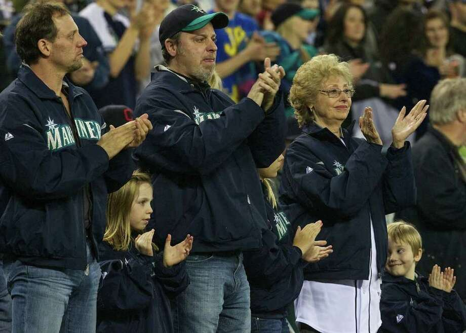 Niehaus family members including Marilyn Niehaus widow of the former Mariners announcer applaud Seattle musician Macklemore's performance  during Opening Day ceremonies at Safeco Field in Seattle Friday April 8, 2011. Photo: Stephen Brashear