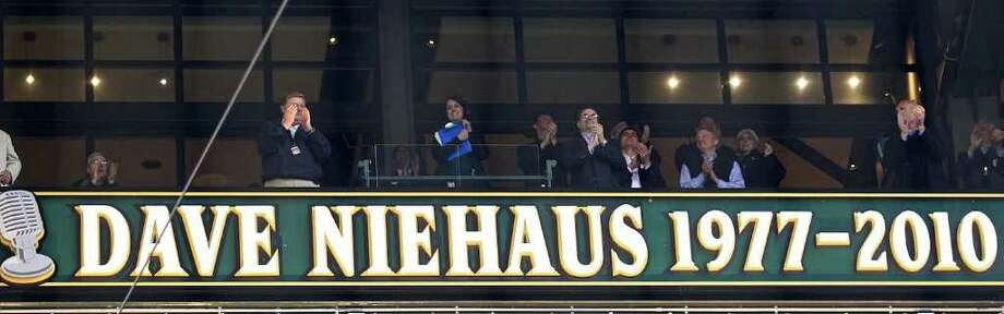 A sign above the Safeco Field press box bearing Dave Niehaus' name was unveiled during Opening Day ceremonies at Safeco Field in Seattle Friday April 8, 2011. Photo: Stephen Brashear