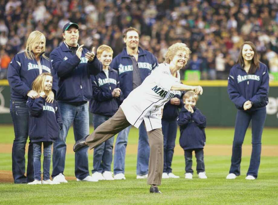 Marilyn Niehaus, widow of former Mariners announcer Dave Niehaus, throws out the ceremonial first pitch during Opening Day ceremonies at Safeco Field in Seattle Friday April 8, 2011. Photo: Stephen Brashear