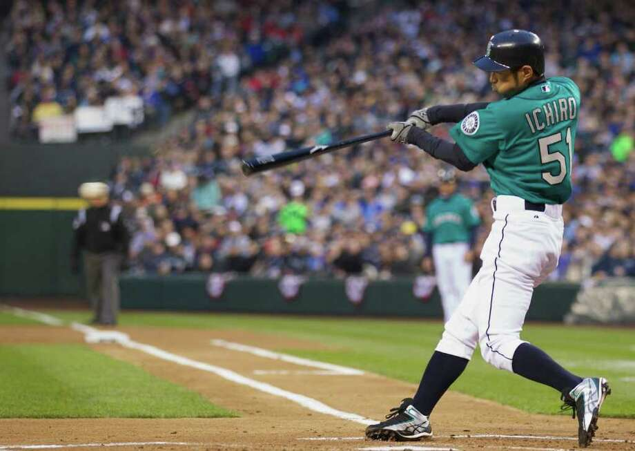 Seattle's Ichiro Suzuki gets a lead off hit during the Opening Day game at Safeco Field in Seattle Friday April 8, 2011. Photo: Stephen Brashear