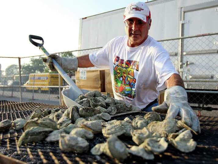 FOR METRO - Roy Elizondo gathers baked oysters for sale during the Fiesta Oyster Bake Friday April 8