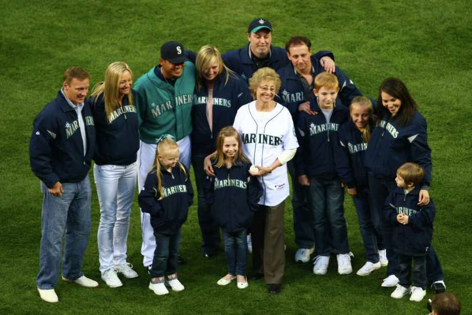 Marilyn Niehaus and her family pose for a photo after she threw out the ceremonial first pitch during the Seattle Mariners home opener against the Cleveland Indians on Friday, April 8, 2011 at Safeco Field in Seattle. (Joshua Trujillo, Seattlepi.com). Photo: JOSHUA TRUJILLO / SEATTLEPI.COM
