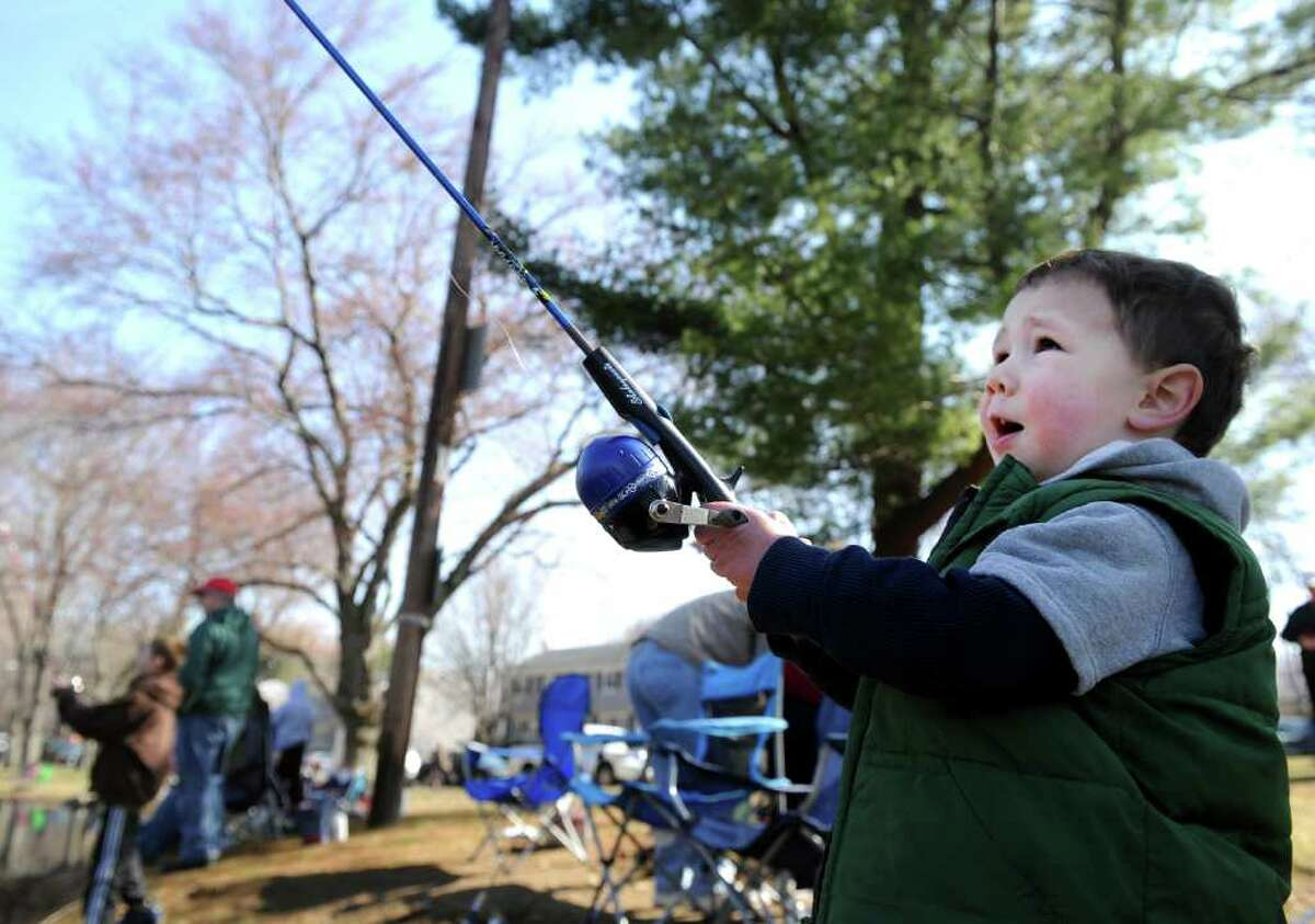 Three-year-old Mitchell Haynes, of Trumbull, waits for a bite Saturday, April 9, 2011 during the annual PAL fishing derby at Gould Manor Park in Fairfield, Conn.