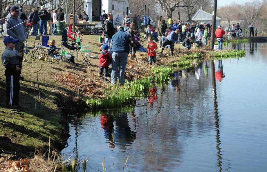 The annual PAL fishing derby at Gould Manor Park in Fairfield, Conn. Saturday, April 9, 2011. Photo: Autumn Driscoll / Connecticut Post