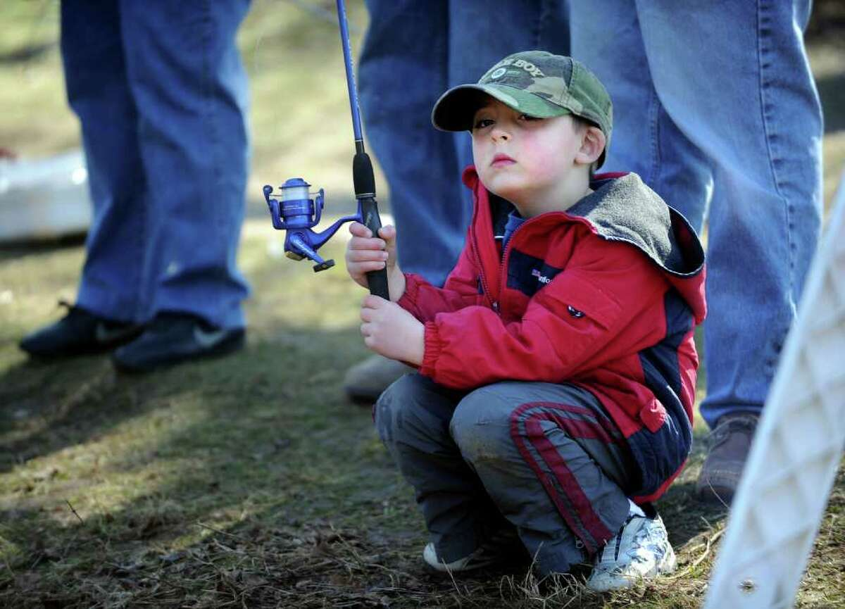 Five-year-old Colin Garamella, of Monroe, waits for a bite Saturday, April 9, 2011 during the annual PAL fishing derby at Gould Manor Park in Fairfield, Conn.
