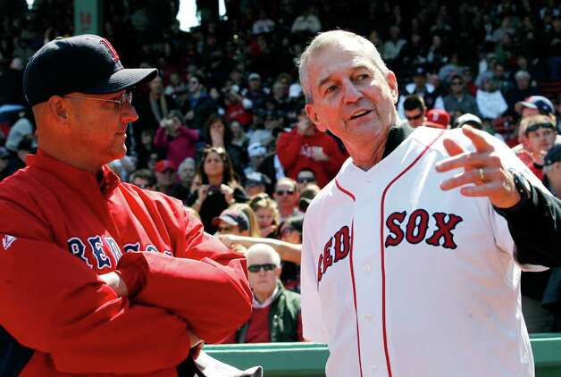 Jim Calhoun, right, coach of the NCAA champions University of Connecticut men's basketball team, chats with Boston Red Sox manager Terry Francona prior to throwing the ceremonial first pitch before a baseball game between the New York Yankees and the Red Sox at Fenway Park in Boston Saturday, April 9, 2011. Photo: Elise Amendola