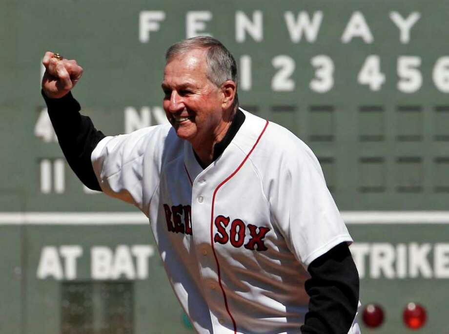 Jim Calhoun, coach of the NCAA champions University of Connecticut men's basketball team, reacts after throwing out the ceremonial first pitch prior to a baseball game between the New York Yankees and the Boston Red Sox at Fenway Park in Boston Saturday, April 9, 2011. Photo: Elise Amendola
