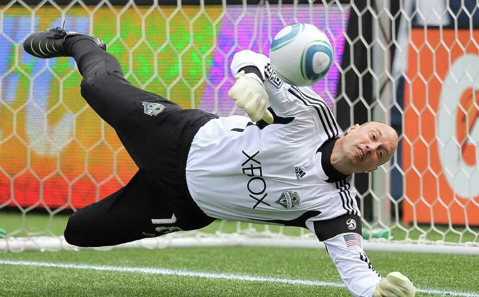 Goalkeeper Kasey Keller #18 of the Seattle Sounders FC falls to the turf after blocking a shot by Pa