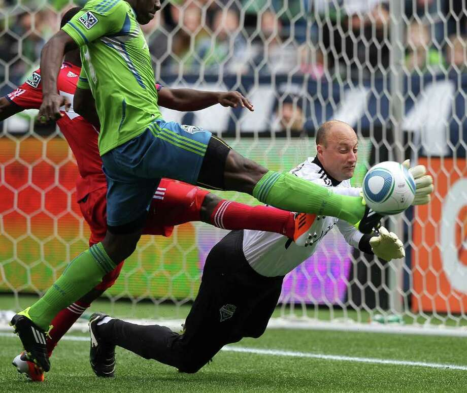 Goalkeeper Kasey Keller #18 of the Seattle Sounders FC blocks a shot by Patrick Nyarko #14 with the help of John Kennedy Hurtado #34 during the game against the Chicago Fire at Qwest Field on April 9, 2011 in Seattle, Washington. Photo: Otto Greule Jr, Getty Images / 2011 Getty Images