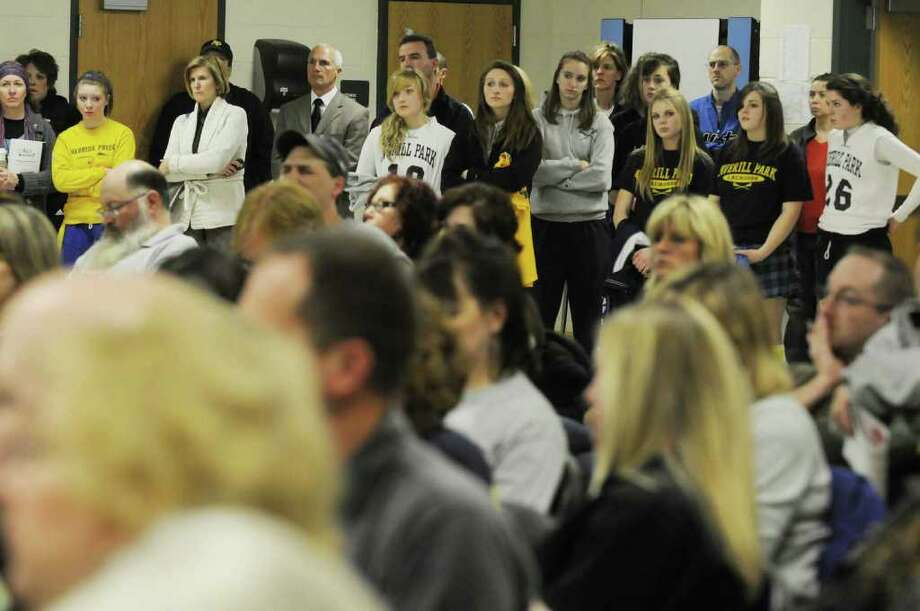 Averill Park High School student athletes listen during a school board meeting in Averill Park on April 5. High school sports programs in the region and state face uncertain  futures as hard times hit school districts.  ( Michael P. Farrell/Times Union ) Photo: Michael P. Farrell