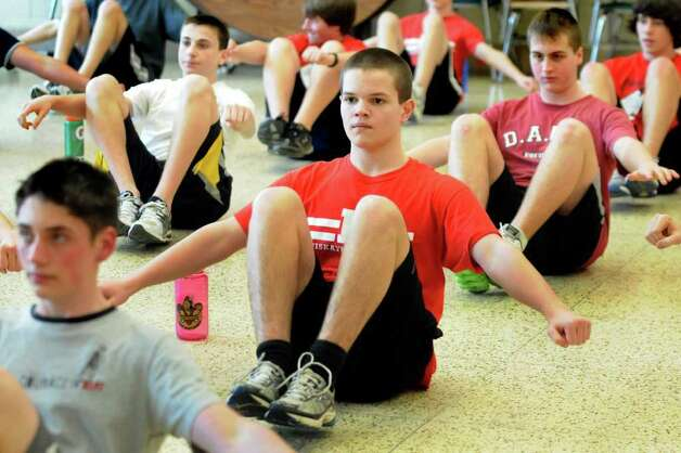Andrew Stewart, 14, center, balances during strength training with the rowing team on Wednesday, April 6, 2011, at Niskayuna High in Niskayuna, N.Y. (Cindy Schultz / Times Union) Photo: Cindy Schultz